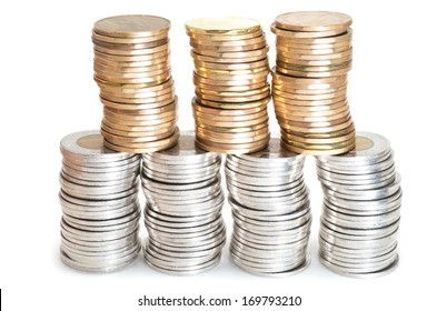Stacks of Canadian coins on white background