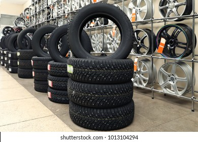 Stacks of car tires in automobile store