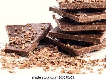 Stacks of chocolate bars with shavings