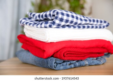 Stacks of clothes on table