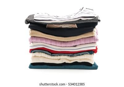 stacks of clothing on white background