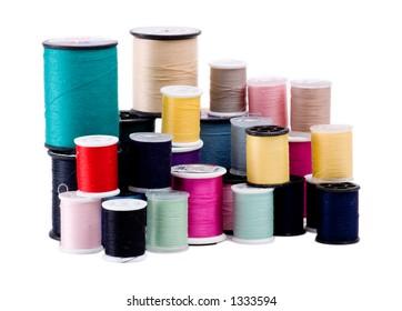 Stacks of clothing thread spools