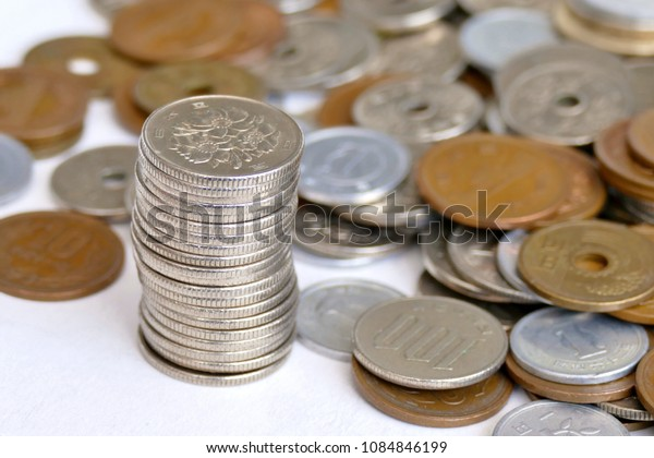 stacks of coin with  background of coins on the desk  on white background