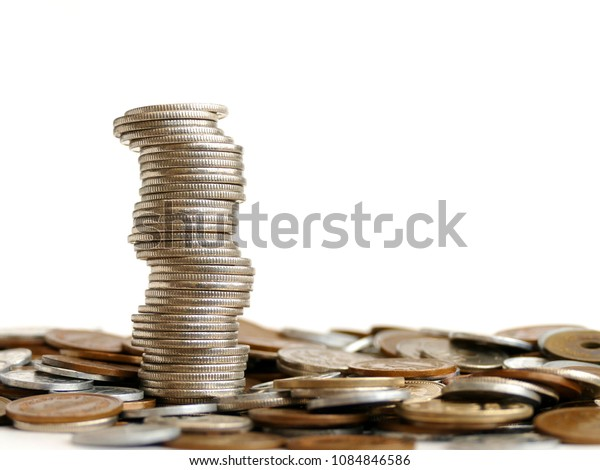 stacks of coins with with  background of coins on the desk  on white background