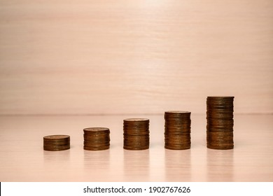 Stacks of coins in the form of a ladder.