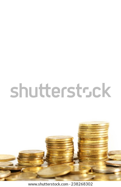 Stacks of coins on white background, Three stacks of coins on white background