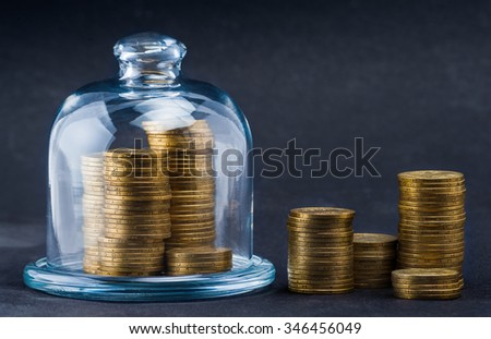 stacks of coins protected under a glass dome