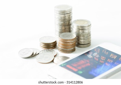 Stacks of coins and stock exchange background