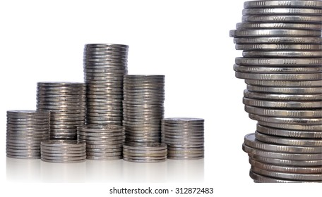 Stacks of coins of various denominations on a white background