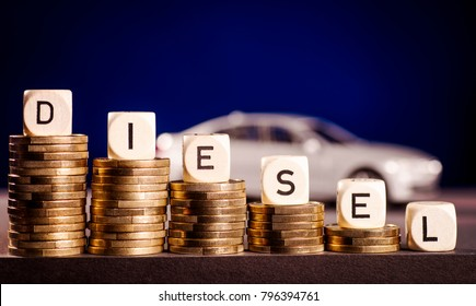 Stacks of coins and the word diesel with a car in the background