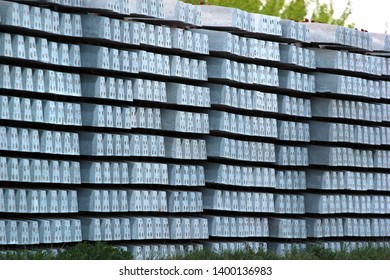 Stacks of concrete sleepers at a railway station
