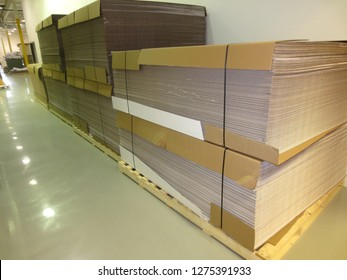 Stacks of corrugate paper for printing on glossy floor