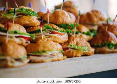 stacks of croissant sandwich at wedding