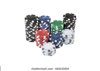 Stacks of different coloured gaming chips isolated against a white background