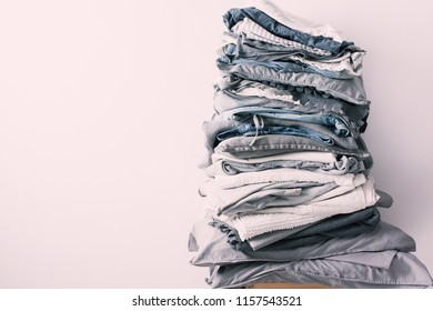 stacks different shades grey white black bed linen textiles clothing background pile concept toning pink