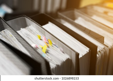 Stacks of document paper and files folder on office desk,Concept Work hard, Lot of work.