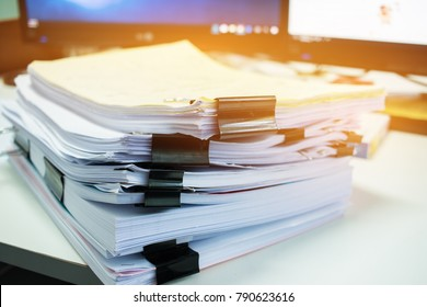 Stacks of documents files for finance of office working.Business report papers or Piles of unfinished document achieves with black clip paper. Concept of Business Annual Report.