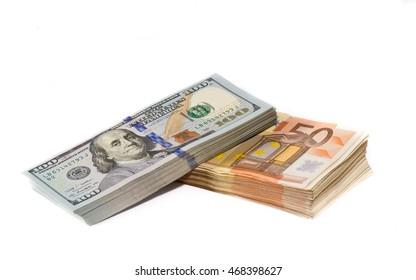 Stacks of dollar and euro bills
