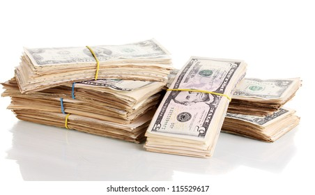 Stacks of dollars isolated on white