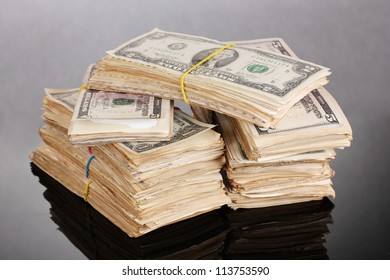 Stacks of dollars on black background