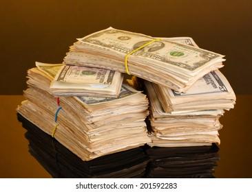 Stacks of dollars on orange background