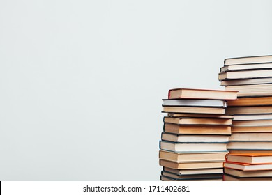 a lot of stacks of educational books in the library on a white background