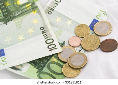 Stacks of  euro coins and banknotes