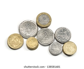 stacks of french francs money coins and centimes in different values isolated on white, top view, ancient french currency