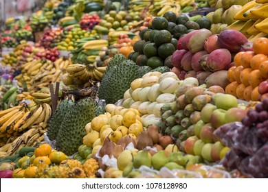 Stacks of fresh and exotic tropical fruit in authentic South American fruit market.