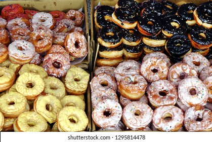 Stacks of fresh sugar frosted donuts are sold at an outdoor market