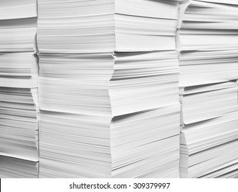 Stacks of freshly cut white paper