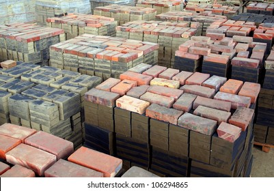 Stacks of freshly formed bricks are drying before firing