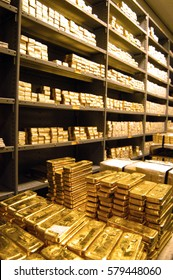 stacks of  gold bars in storage in a bank vault