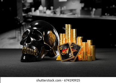 Stacks of gold coins with shiny skull and ace of hearts poker hand. 3D illustration metaphor of high risk, high reward.