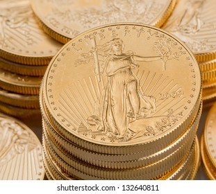 Stacks of gold eagle one troy ounce golden coins from US Treasury mint