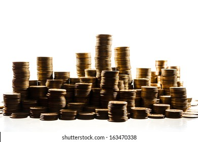 stacks of golden coins isolated on white background