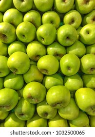Stacks of Green Apples