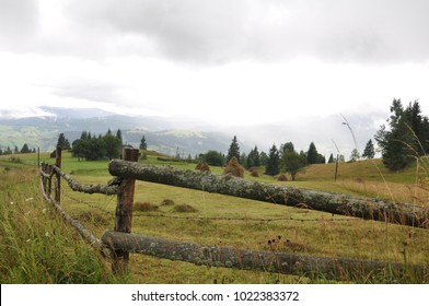 stacks of hay on a field in a mountain valley in the Carpathian mountains,