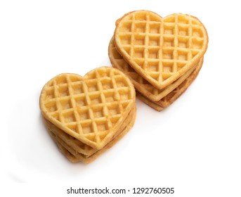 Stacks  of heart shaped waffles isolated on white
