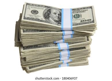Stacks of hundred-dollar bills on white background