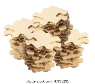 Stacks of Jigsaw Puzzle Pieces on White Background