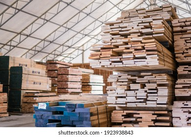Stacks of lumber being stored in a warehouse