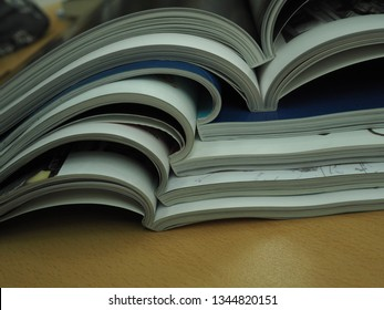 stacks of magazines, folded and unfolded condition