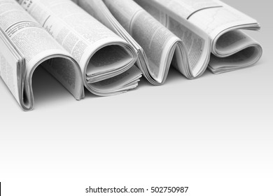 Stacks of modern newspapers, composed in form of word NEWS on gradient background. Concept of news and events of company
