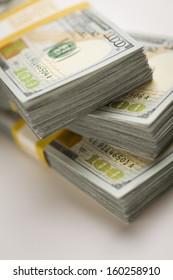 Stacks of Newly Designed One Hundred Dollar Bills with Selective Focus.
