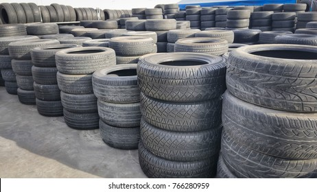 stacks of old used tires for saleat  store. Second hand car tires