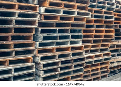 Stacks of old wooden pallets in an industrial yard