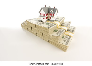 Stacks of One Hundred Dollar Bills with Small House on Slight Gradation.