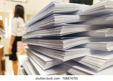 Stacks Paper document with blur working woman on office background