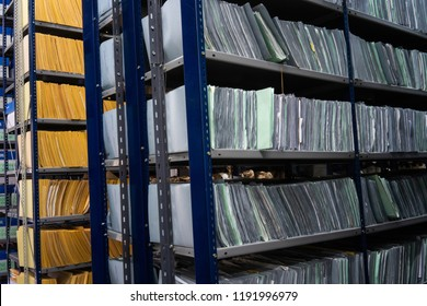 Stacks of papers and folders in library Office Files
